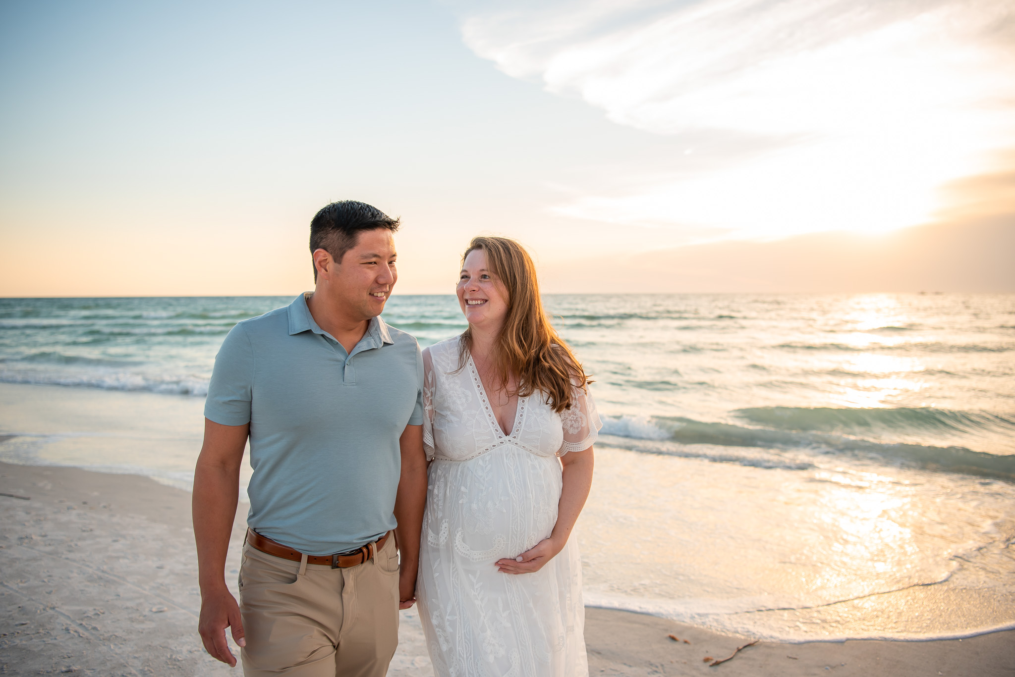 Couple on the beach for their Maternity session